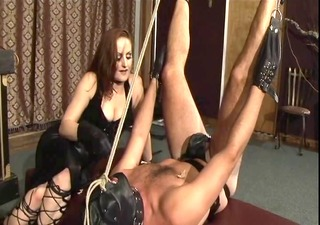 red head dominatrix spanks a lads ass